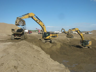 excavator and truck moving dirt